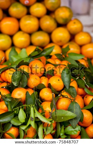 A pile of Tangerines Displayed in a Street market in Cambodia - stock photo