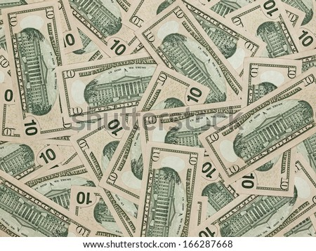 A Pile of Ten Dollar Bills as a Money Background - stock photo