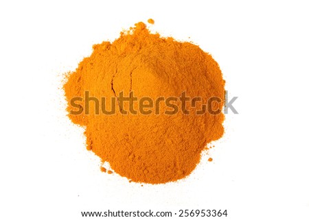 A pile of the colorful spice, ground turmeric or curcumin on a white background - stock photo