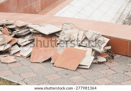 A pile of trash, various disposed, broken tiles  - stock photo