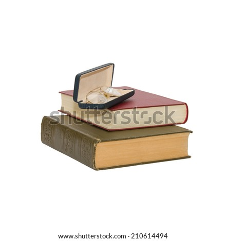 A pile of two books with eyeglass. White isolated on background - stock photo