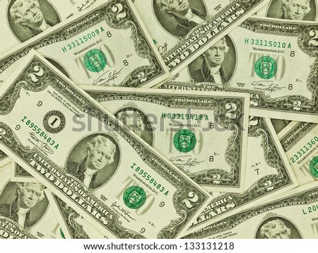 A Pile of Two Dollar Bills as a Money Background - stock photo