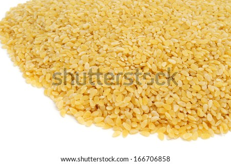 a pile of uncoocked pastina, a variety of tiny pieces of pasta used in broth soups, on a white background