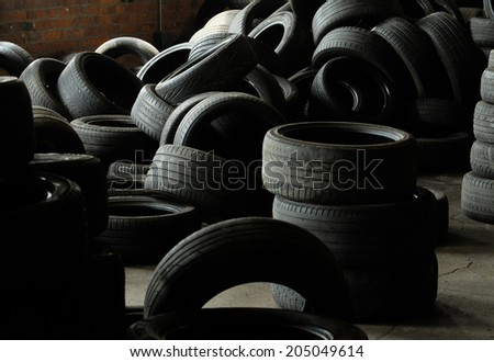 A pile of used car and vehicle tyres (tires)