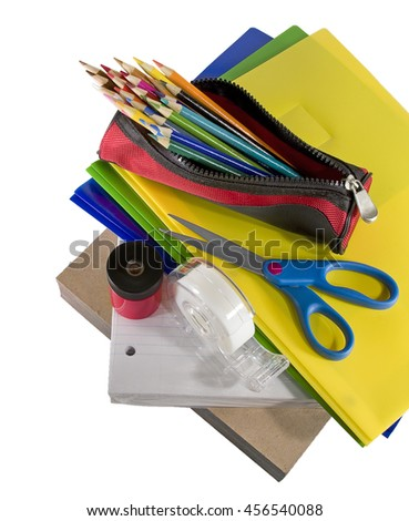 A pile of various school supplies.