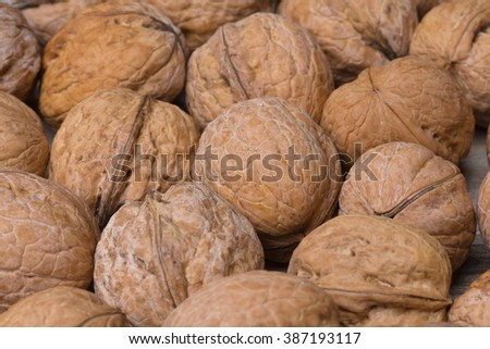 A pile of walnuts in the canvas bag
