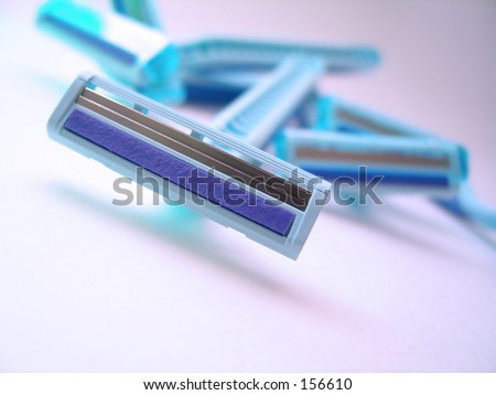 A pile of womens razors.