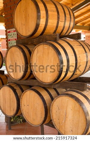 a pile of wooden barrels used for mezcal manufacturing in Oaxaca Mexico - stock photo