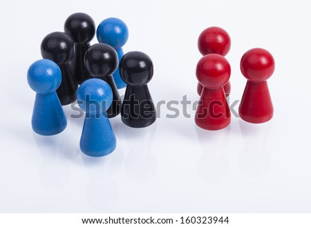 A pile of wooden pawns with color red,blue and black
