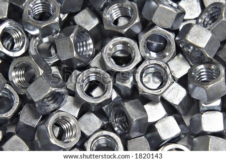 A pile of zinc plated hex nuts.