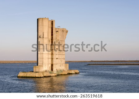 a pillar similar to those used for the Dutch Delta Works to protect holland form high sea level, this one is from the dutch museum neeltje jans - stock photo