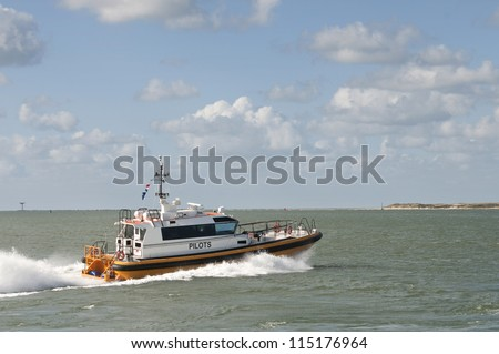 a pilot boat  in the harbor - stock photo