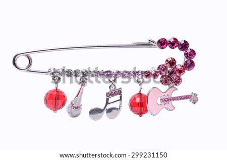 a pin with a pendants and gems isolated on white - stock photo