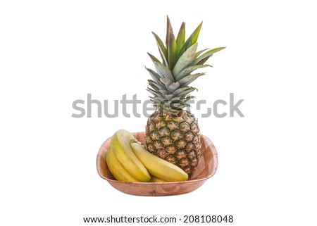 A Pineapple and Bananas in a Wooden Fruit Bowl Isolated on a White Background - stock photo