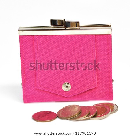 A pink leather purse with some coins in front of it. - stock photo