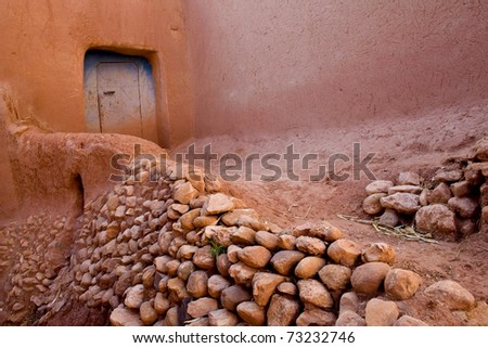 A pink narrow street in a village in Morocco (Africa) - stock photo
