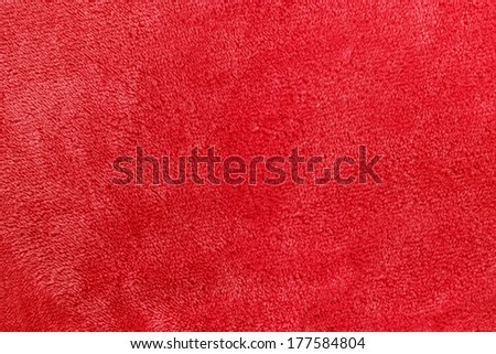 a pinkish red background of warm, cozy micro-fleece blanket fabric - stock photo
