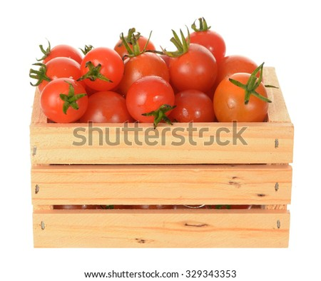 a pint of cherry tomato isolated on white