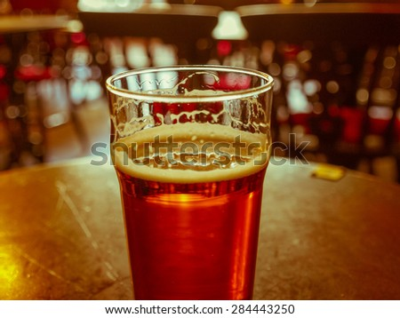 A pint of English ale beer in a pub - stock photo