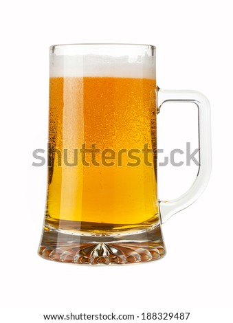 A pint of sparkling beer isolated on white background