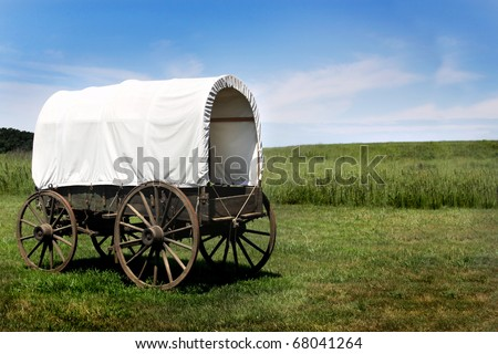 A pioneer covered wagon on the Prairie. - stock photo
