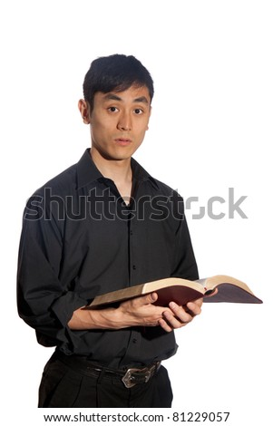 A pious Asian man praying on his knees - stock photo