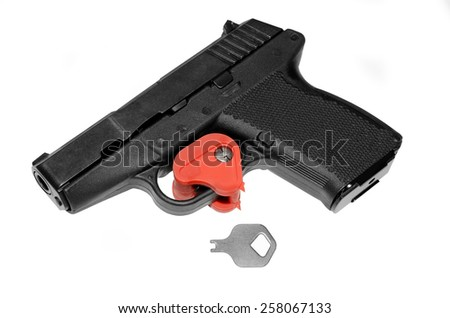 A pistol that has the trigger locked with a key.  A firearm safety feature.