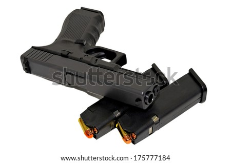 A pistol with bullets on a white background. - stock photo