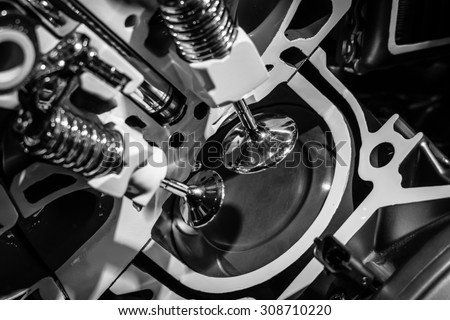 A piston engine in cross section. Close-up. Black and white. - stock photo