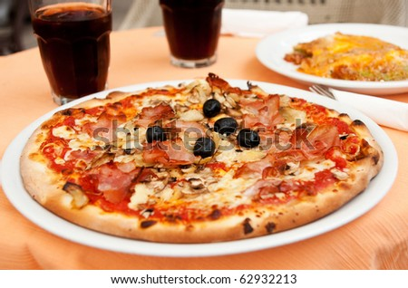 a pizza on a plate - stock photo