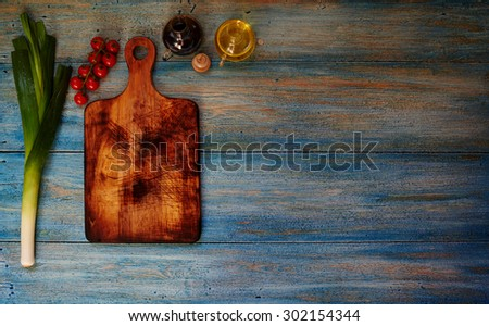 A place for advertising on blue vintage wooden desk on which the products are - stock photo