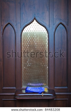 A place for religion in the church confessional, Chris. - stock photo