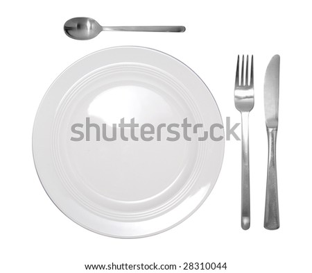 a place setting containing a plate, knife, fork and spoon - stock photo