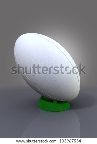 A plain white textured rugby ball on a blue kicking tee on a plain background - stock photo