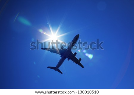 A plane is flying in the sky - stock photo