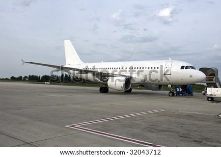 a plane parked at Charles de gaules airport, Paris, France - stock photo