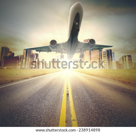 A plane takes off from a runway - stock photo