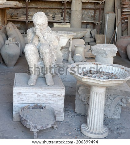 A plaster cast of the victim's body (coachman) flooded with lava, Pompeii - stock photo
