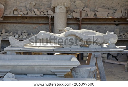 A plaster cast of the victim's body flooded with lava, Pompeii - stock photo
