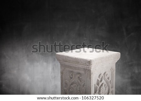 A Plaster column with nothing on top. - stock photo