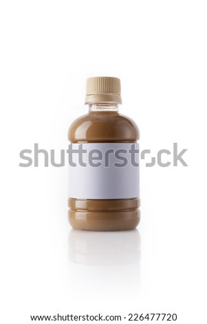 A plastic bottle with coffee(cafe late) with blank label reflective bottom isolated white.