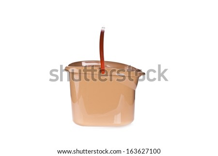 A plastic brown mop bucket or pale isolated on a white background