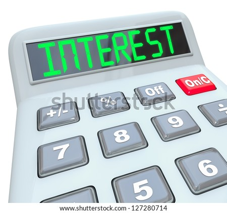 A plastic calculator displays the word Interest as you figure how the percentage interest rate you will pay on borrowed money or the money you will make on investments - stock photo