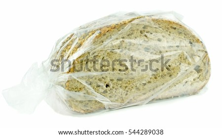 A plastic freezer bag with sliced wholemeal grain bread on a white background