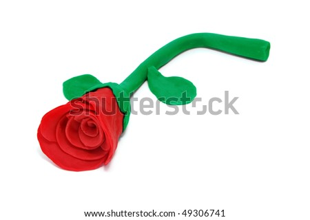 a plasticine red rose isolated on a white background