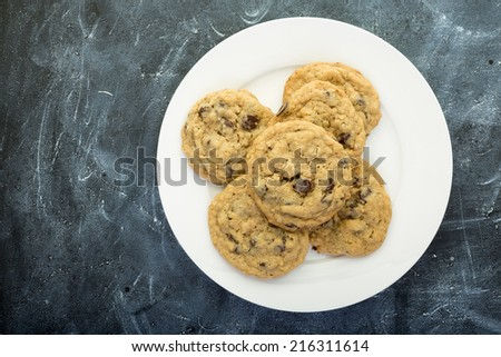 A plate full of chocolate chip or Toll House cookies from above. - stock photo