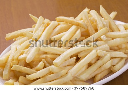 A plate full of delicious shoestring style french fries
