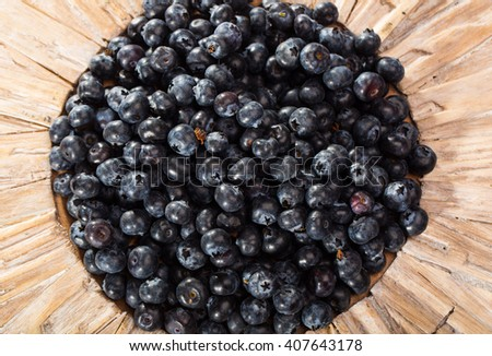 A plate full of fresh picked healthy blueberries - stock photo