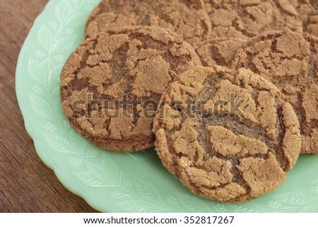 A plate full of home made ginger snap cookies.