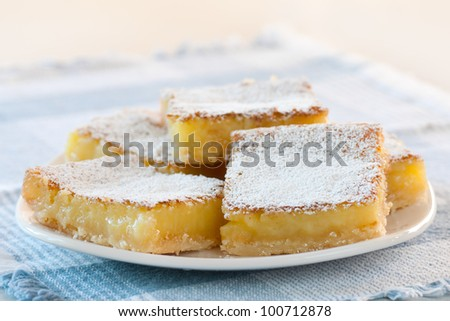A Plate Full of Tasty Lemon Squares Freshly Baked and Ready for Eating on a Special Occasion or as Dessert after Lunch or Dinner
